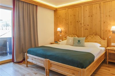 comfort room in Hotel Rosengarten with antic spruce wood and  balcony