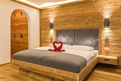 comfort room in Hotel Rosengarten with old spruce wood and balcony