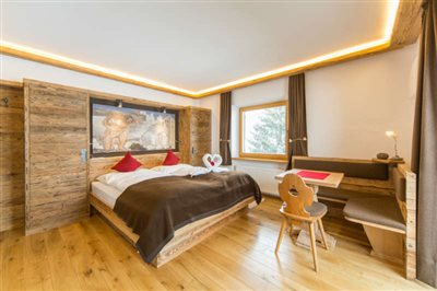 comfort room in Hotel Rosengarten with old spruce wood and fresco of Begher